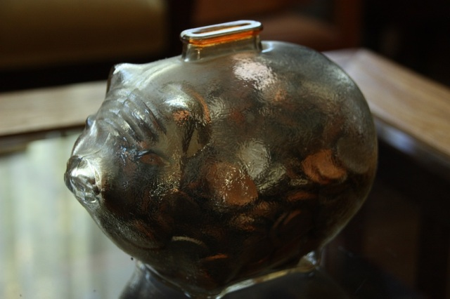 This vintage glass piggy bank was given to my son when he was an infant. it has no plug - you have to break it to get the money out. Great way to save!