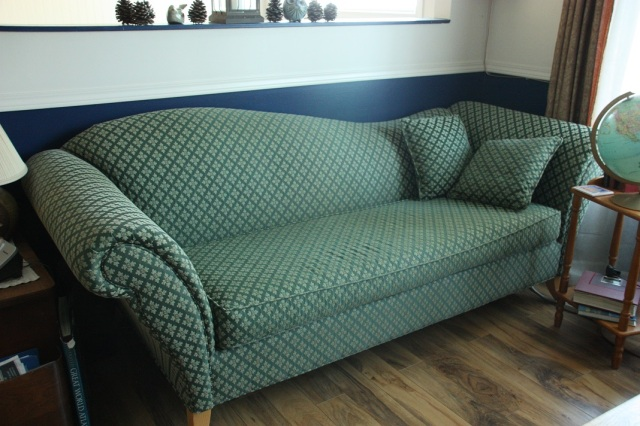 i love the graceful, art-deco look of this sofa